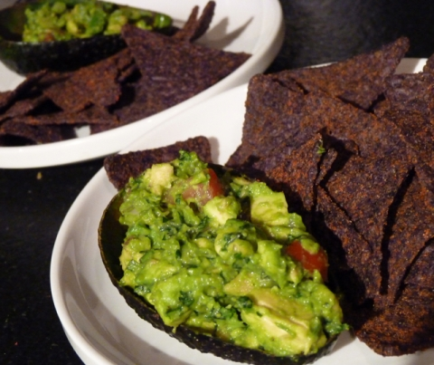 Homemade Guacamole with red hot a blue organic chips