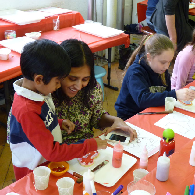 Agastya and Devika working on their heart cookie